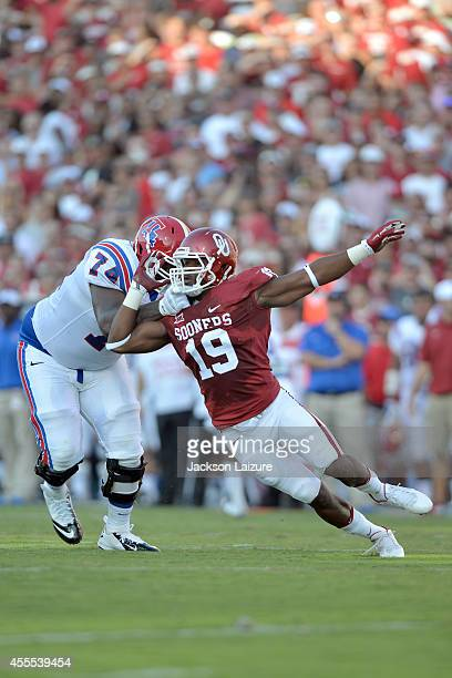 Linebacker Eric Striker of the Oklahoma Sooners tries to get around offensive lineman Mitchell Bell of the Louisiana Tech Bulldogs at Gaylord Family...