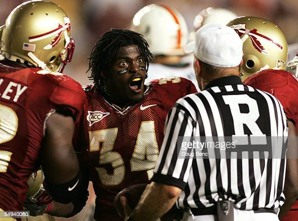 Linebacker Ernie Sims of the Florida State Seminoles argues with the referee after being called for a penalty for taking off his helmet in a game...
