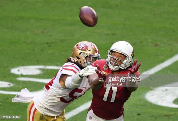 Linebacker Fred Warner of the San Francisco 49ers breaks up a pass to wide receiver Larry Fitzgerald of the Arizona Cardinals during the first half...
