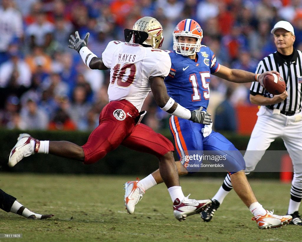 Linebacker Geno Hayes #10 of the Florida State Seminoles tries to sack quarterback Tim Tebow #15 of the Florida Gators during the game at Ben Hill Griffin Stadium on November 24, 2007 in Gainesville, Florida