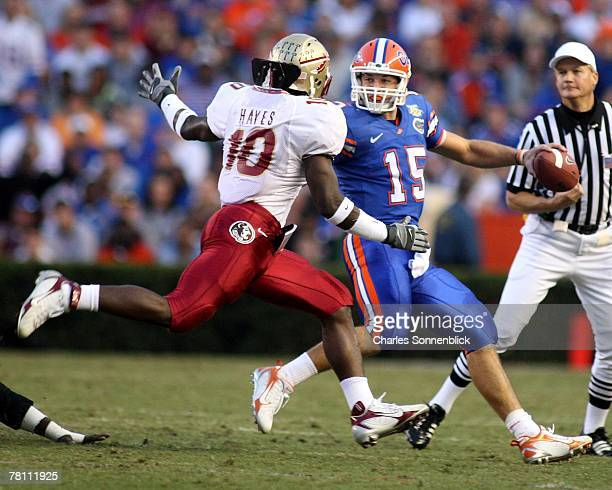Linebacker Geno Hayes of the Florida State Seminoles tries to sack quarterback Tim Tebow of the Florida Gators during the game at Ben Hill Griffin...