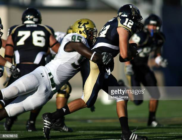 Linebacker George Selvie of the University of South Florida sacks quarterback Paul McCall the Florida International University Panthers on September...