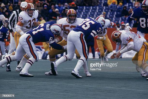 Linebacker Harold McClinton and Brad Dusek of the Washington Redskins stops running back Mike Collier of the Buffalo Bills on December 4 1977 at Rich...