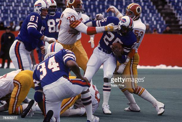 Linebacker Harold McClinton and safety Ken Houston stop running back Roland Hooks of the Buffalo Bills on December 4 1977 at Rich Stadium in Buffalo...
