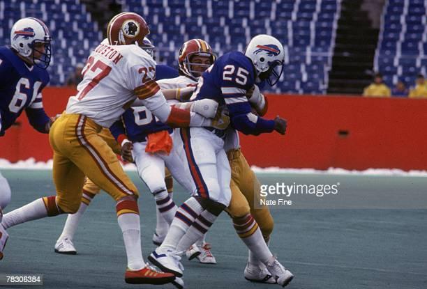 Linebacker Harold McClinton stops running back Roland Hooks of the Buffalo Bills on December 4 1977 at Rich Stadium in Buffalo New York The Redskins...