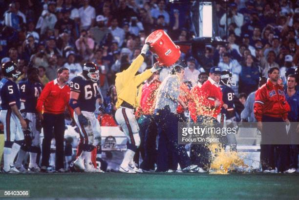 Linebacker Harry Carson of the New York Giants splashes a bucket of Gatorade over the head of Head coach Bill Parcells after defeating the Denver...