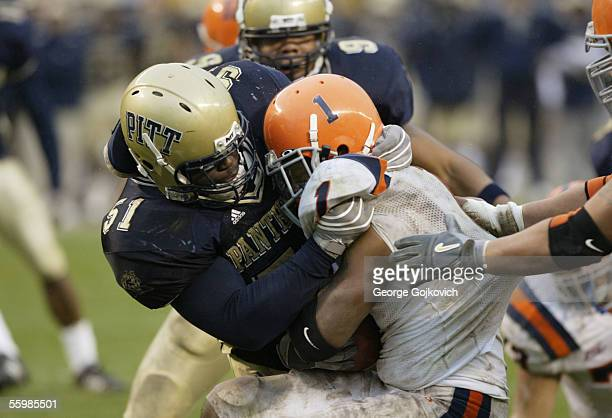 Linebacker H.B. Blades of the University of Pittsburgh Panthers tackles running back Damien Rhodes of the Syracuse University Orangemen during a Big...