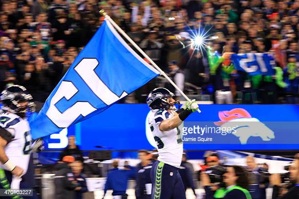 Linebacker Heath Farwell of the Seattle Seahawks leads the team onto the field at start of Super Bowl XLVIII at MetLife Stadium on February 2 2014 in...