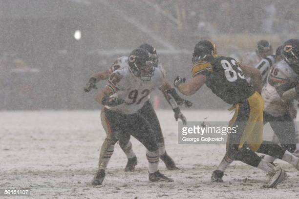 Linebacker Hunter Hillenmeyer of the Chicago Bears in action against tight end Heath Miller of the Pittsburgh Steelers as snow falls at Heinz Field...