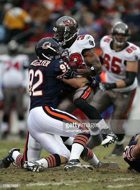 Linebacker Hunter Hillenmeyer of the Chicago Bears stops running back Michael Pittman of the Tampa Bay Buccaneers December 17 2006 at Soldier Field...