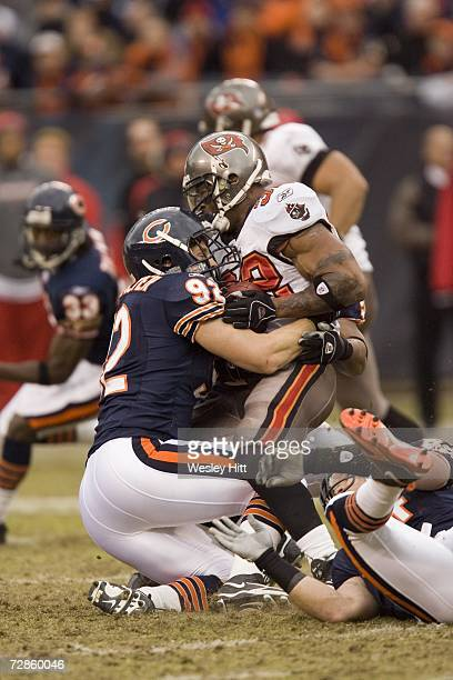 Linebacker Hunter Hillenmeyer of the Chicago Bears tackles running back Michael Pittman of the Tampa Bay Buccaneers at Soldier Field on December 17...