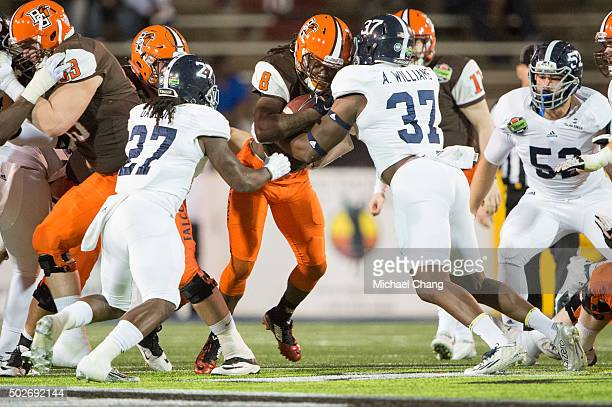Linebacker Ironhead Gallon and linebacker Antwione Williams of the Georgia Southern Eagles tackle running back Travis Greene of the Bowling Green...