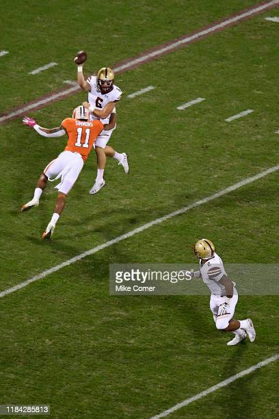Linebacker Isaiah Simmons of the Clemson Tigers pressures quarterback Dennis Grosel as Grosel attempts a pass to running back AJ Dillon of the Boston...