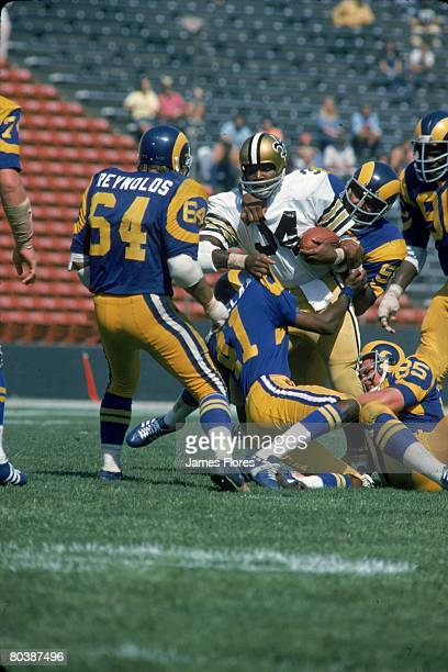 Linebacker Isiah Robertson of the Los Angeles Rams stops running back Jess Phillips of the New Orleans Saints at the Los Angeles Memorial Coliseum on...