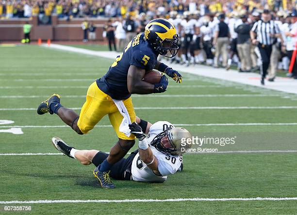 Linebacker Jabrill Peppers of the Michigan Wolverines avoided Ryan Severson of the Colorado Buffaloes to score on a 54yard punt return for a...