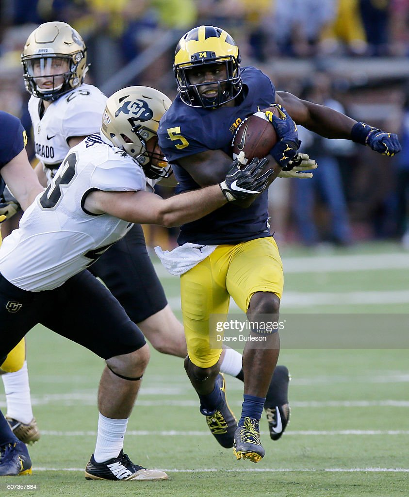 Linebacker Jabrill Peppers #5 of the Michigan Wolverines breaks away from Chris Bounds #43 of the Colorado Buffaloes on a 54-yard punt return for a touchdown during the fourth quarter at Michigan Stadium on September 17, 2016 in Ann Arbor, Michigan. Michigan defeated Colorado 45-28.