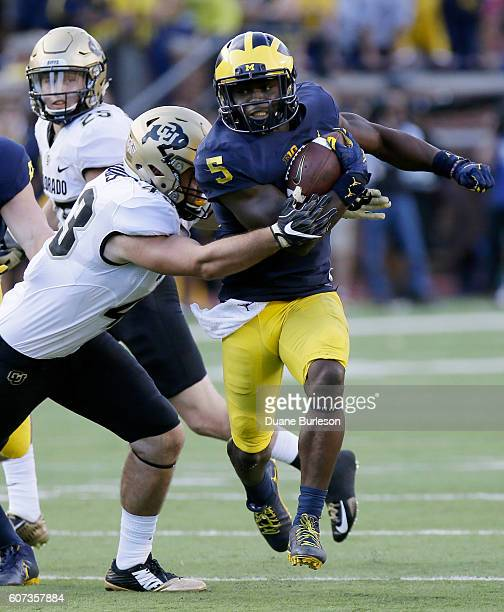 Linebacker Jabrill Peppers of the Michigan Wolverines breaks away from Chris Bounds of the Colorado Buffaloes on a 54yard punt return for a touchdown...