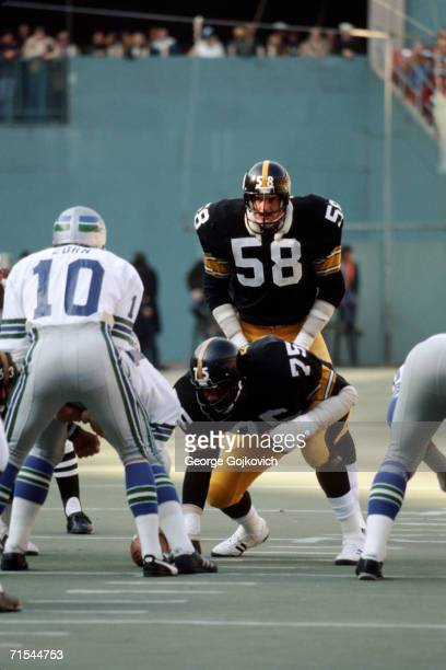 Linebacker Jack Lambert and defensive lineman 'Mean Joe' Greene of the Pittsburgh Steelers in action against quarterback Jim Zorn of the Seattle...