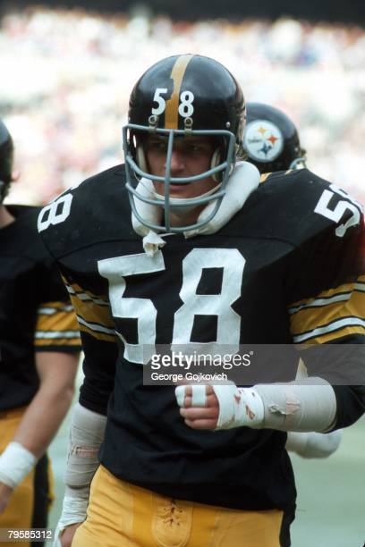Linebacker Jack Lambert of the Pittsburgh Steelers looks on from the sideline during a game against the Denver Broncos at Three Rivers Stadium on...