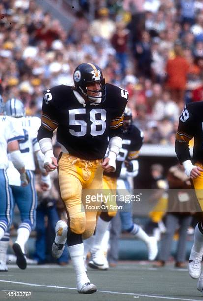 Linebacker Jack Lambert of the Pittsburgh Steelers runs off the field against the Dallas Cowboys during an NFL football game November 20 1977 at...