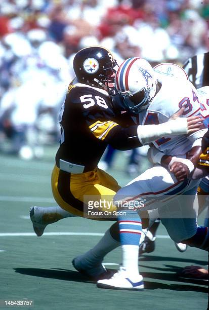 Linebacker Jack Lambert of the Pittsburgh Steelers tackles Earl Campbell of the Houston Oilers during an NFL football game September 7 1980 at Three...