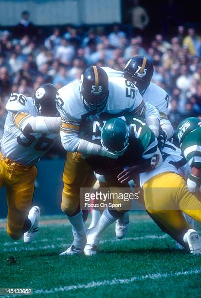 Linebacker Jack Lambert of the Pittsburgh Steelers tackles Kirk Springs of the New York Jets during an NFL football game December 10 1983 at Shea...