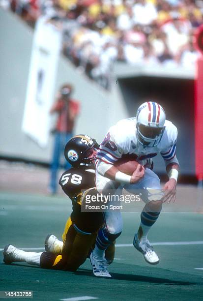 Linebacker Jack Lambert of the Pittsburgh Steelers tackles Mike Renfro of the Houston Oilers during an NFL football game September 7 1980 at Three...