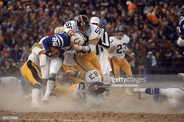 Linebacker Jack Lambert of the Pittsburgh Steelers tackles running back Lydell Mitchell of the Baltimore Colts during the AFC Divisional Playoff game...