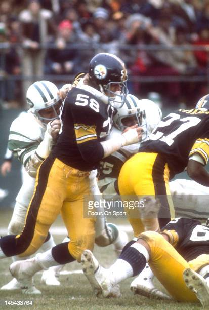 Linebacker Jack Lambert of the Pittsburgh Steelers tackles Steve Davis of the New York Jets during an NFL football game November 30 1975 at Shea...