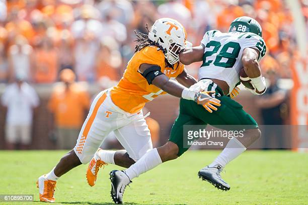 Linebacker Jalen Reeves-Maybin of the Tennessee Volunteers looks to tackle running back Dorian Brown of the Ohio Bobcats at Neyland Stadium on...