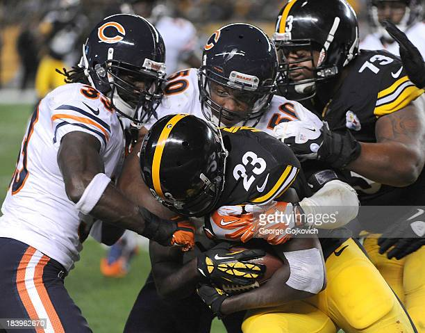 Linebacker James Anderson and cornerback Charles Tillman of the Chicago Bears tackle running back Felix Jones of the Pittsburgh Steelers as offensive...