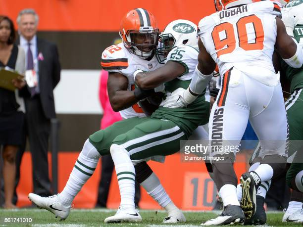 Linebacker James Burgess Jr #52 of the Cleveland Browns tackles running back Elijah McGuire of the New York Jets in the backfield in the first...
