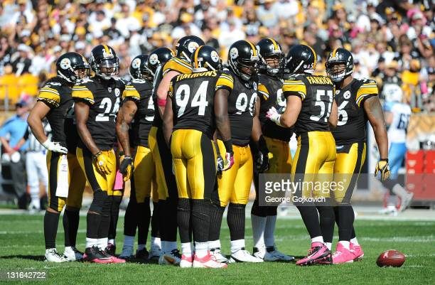 Linebacker James Farrior of the Pittsburgh Steelers huddles with other members of the defense including Troy Polamalu Ike Taylor Lawrence Timmons...