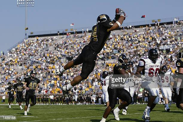 Linebacker James Kinney of the Missouri Tigers jumps into the endzone for a touchdown and an unsportsmanlike conduct penalty after intercepting a...