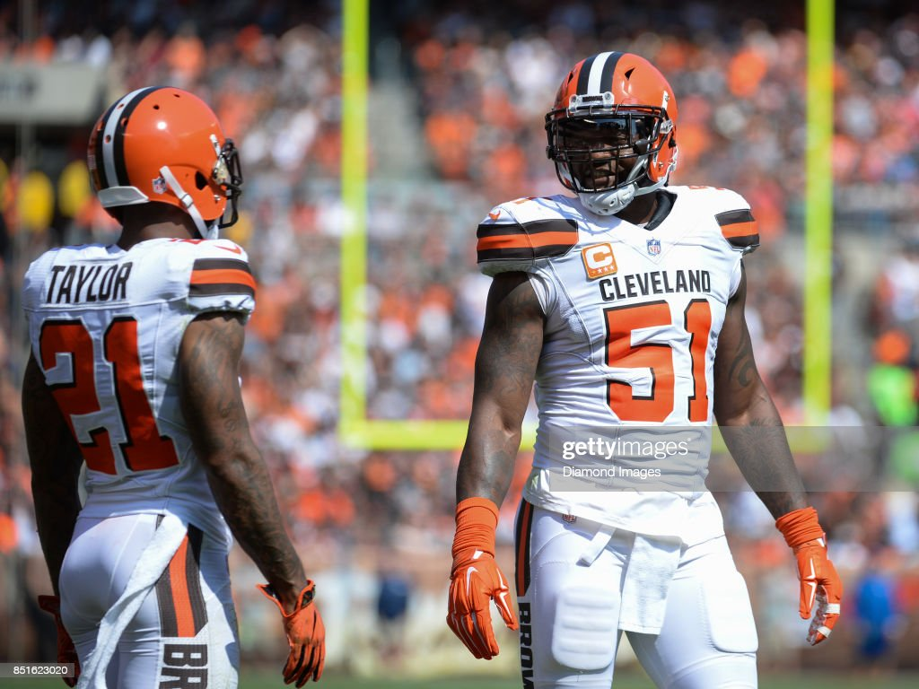 075e9770ef9 ... Linebacker Jamie Collins Sr. 51 of the Cleveland Browns converses with  cornerback Jamar Taylor ...