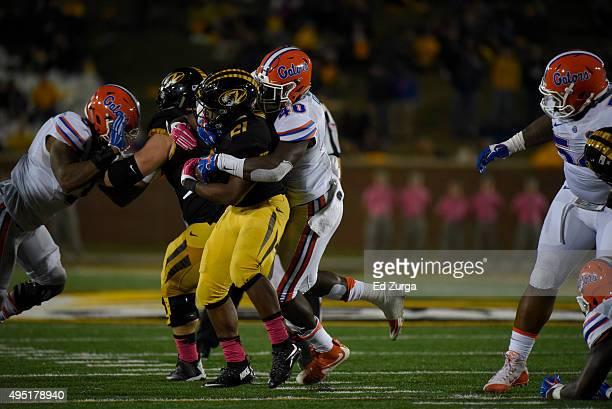 Linebacker Jarrad Davis of the Florida Gators tackles Ish Witter of the Missouri Tigers at Memorial Stadium on October 10 2015 in Columbia Missouri