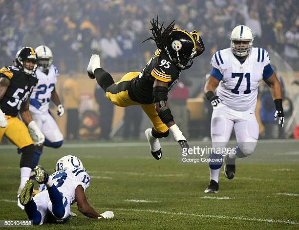 Linebacker Jarvis Jones of the Pittsburgh Steelers is in the air after he was upended by wide receiver TY Hilton of the Indianapolis Colts after...