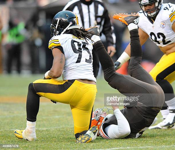 Linebacker Jarvis Jones of the Pittsburgh Steelers knocks down quarterback Brandon Weeden of the Cleveland Browns during a game against the Cleveland...