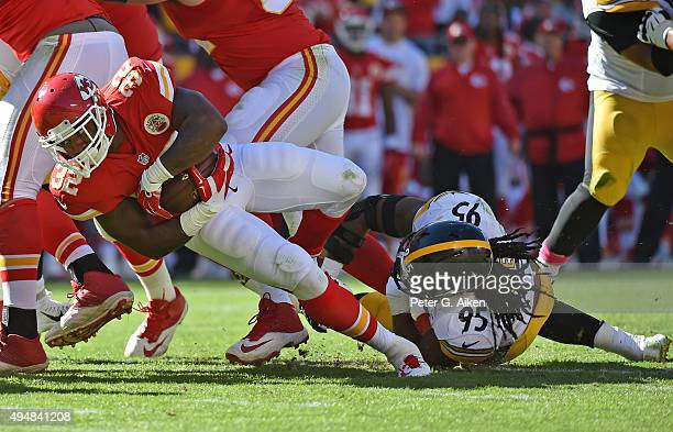 Linebacker Jarvis Jones of the Pittsburgh Steelers tackles running back Spencer Ware of the Kansas City Chiefs during the second half on October 25...