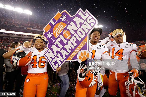 Linebacker Jarvis Magwood safety Isaiah Simmons and wide receiver Diondre Overton of the Clemson Tigers celebrate after defeating the Alabama Crimson...