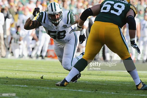 Linebacker Jason Babin of the New York Jets rushes against the Green Bay Packers at Lambeau Field on September 14 2014 in Green Bay Wisconsin