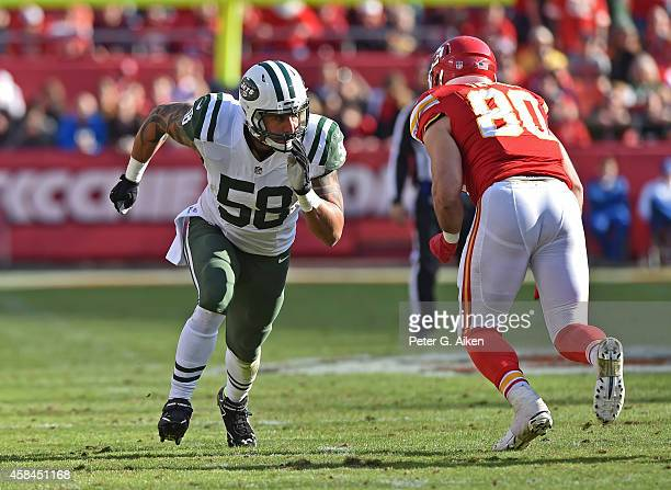 Linebacker Jason Babin of the New York Jets rushes against tight end Anthony Fasano of the Kansas City Chiefs during the second half on November 2...