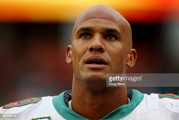 Linebacker Jason Taylor of the Miami Dolphins looks up as the last few moments of the game tick away against the Pittsburgh Steelers calls out a play...