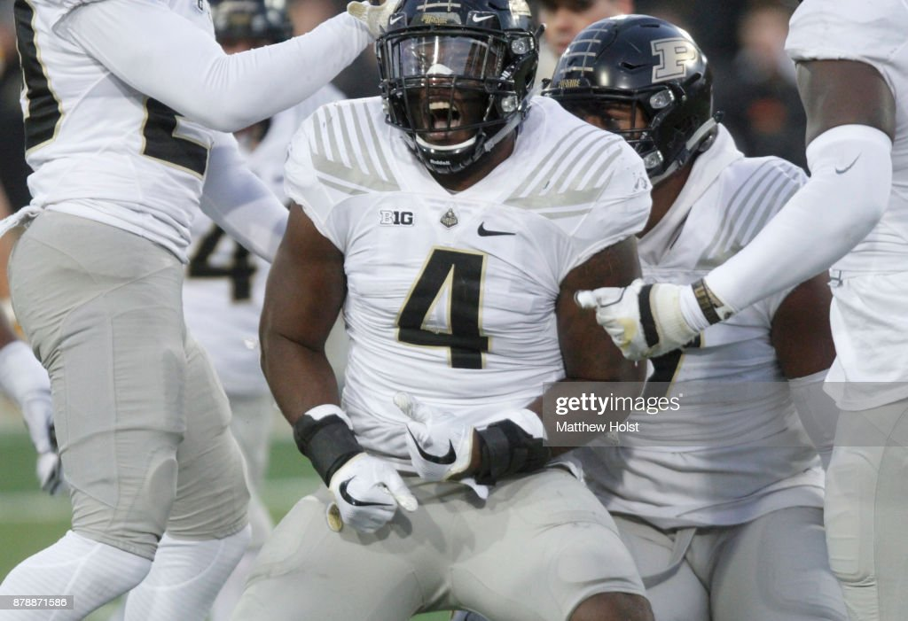Linebacker Ja'Whaun Bentley #4 of the Purdue Boilermakers celebrates a stop in the third quarter against the Iowa Hawkeyes, on November 18, 2017 at Kinnick Stadium in Iowa City, Iowa.