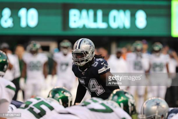 Linebacker Jaylon Smith of the Dallas Cowboys calls a coverage against the New York Jets in the first half at MetLife Stadium on October 13, 2019 in...