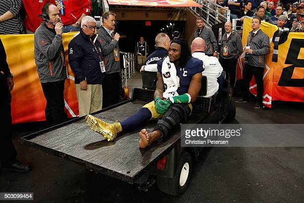 Linebacker Jaylon Smith of the Notre Dame Fighting Irish is carted off the field after an injury during the first quarter of the BattleFrog Fiesta...