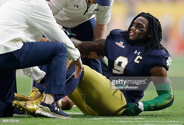Linebacker Jaylon Smith of the Notre Dame Fighting Irish lays on the field after an injury during the first quarter of the BattleFrog Fiesta Bowl...