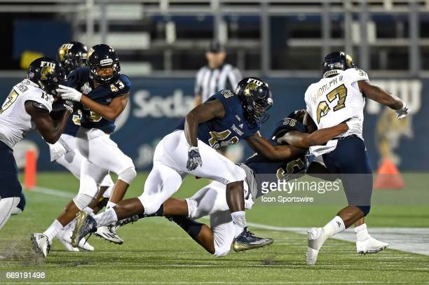 FIU linebacker Jean Estinor and linebacker Daniel King pursue running back Alfonso Randolph as the FIU Golden Panthers held their annual spring game...