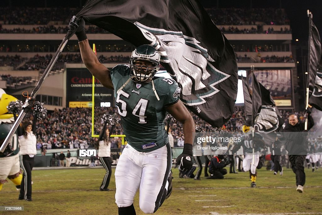 Linebacker Jeremiah Trotter #54 of the Philadelphia Eagles leads the team onto the field during the game against the Carolina Panthers on December 4, 2006 at Lincoln Financial Field in Philadelphia, Pennsylvania. The Eagles defeated the Panthers 27-24.