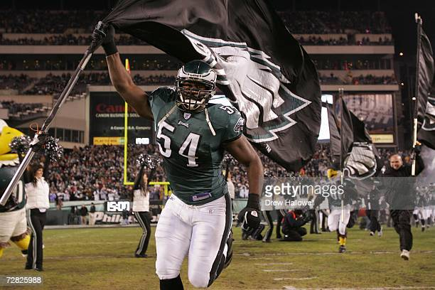 Linebacker Jeremiah Trotter of the Philadelphia Eagles leads the team onto the field during the game against the Carolina Panthers on December 4,...
